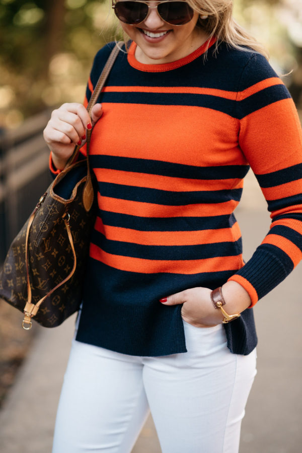 Bows & Sequins wearing Gucci aviators, a Sail to Sable orange and blue striped sweater, and white denim with a Louis Vuitton Neverfull tote.
