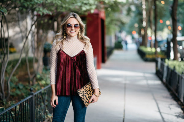 Bows & Sequins wearing round retro sunglasses, a Zara lace turtleneck, Massimo Dutto velvet cami, Old Navy Rockstar jeans, and Tuckernuck gold earrings with a Clare V leopard clutch.