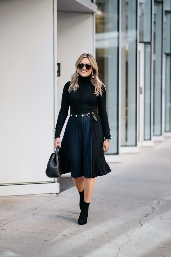 Bows & Sequins wearing a ribbed turtleneck bodysuit with a pleated midi skirt, a Claudie Pierlot pearl studded belt, ankle booties, and a Polene bag.