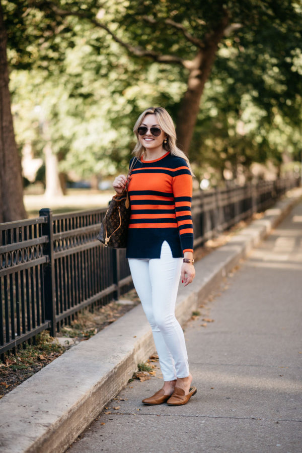 Fashion and lifestyle writer Bows & Sequins wearing a Sail to Sable fall sweater, Old Navy white denim, and Dune London leather loafers with Gucci aviators and a Louis Vuitton tote.