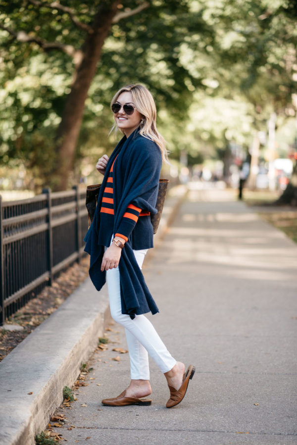 Chicago blogger Bows & Sequins wearing a navy blue cashmere wrap with Gucci aviators, Old Navy white jeans and Dune London leather loafers.