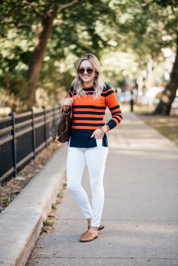 Bows & Sequins wearing a Sail to Sable orange and blue sweater with Gucci aviators, a Gucci cuff bracelet (via Switch), a Louis Vuitton Neverfull tote, Old Navy white denim and Dune London leather loafers.