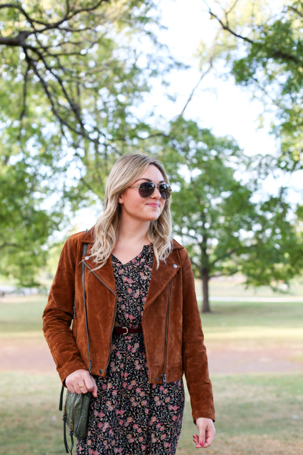 Bows & Sequins wearing a Blank NYC cognac suede jacket and aviators.