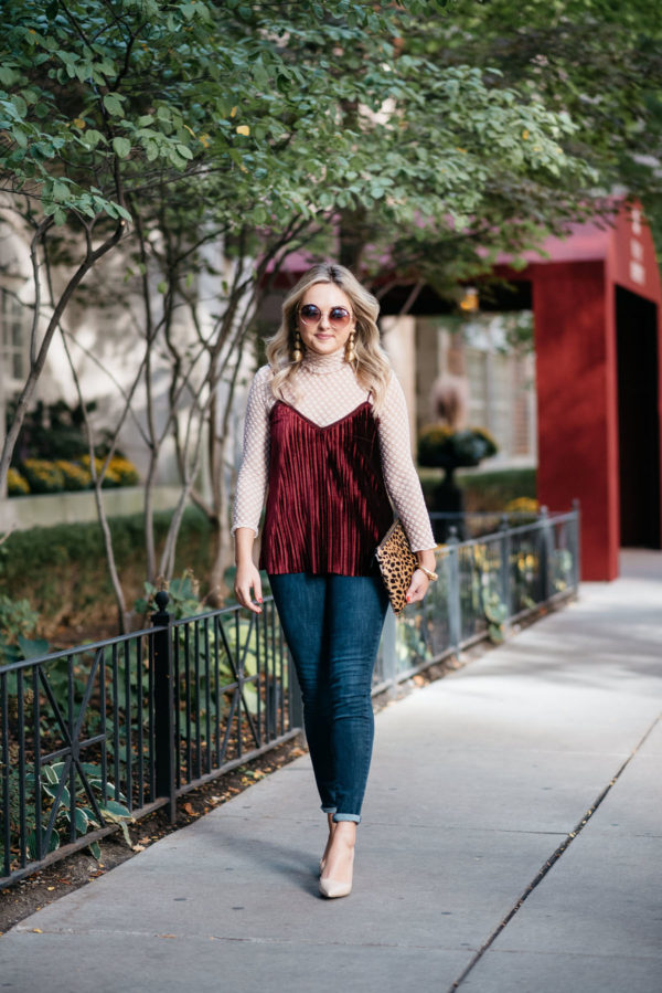 Chicago-based fashion-focused blogger Bows & Sequins wearing round retro sunglasses, a Zara lace turtleneck, Massimo Dutto velvet cami, Old Navy Rockstar jeans, Kate Spade pumps and Tuckernuck gold earrings with a Clare V leopard clutch.