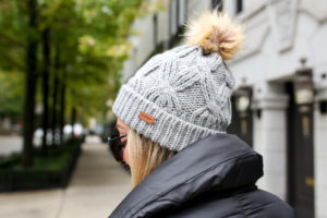 f3189e17319 Jessica Sturdy of Bows   Sequins wearing a fur pom beanie and Barbour  Rockingham jacket.