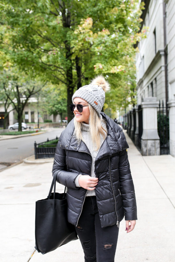 Jessica Sturdy wearing a Barbour quilted jacket with a cable knit sweater, Ashridge beanie, and Old Navy black denim with a black leather tote.