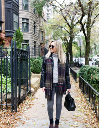 Chicago blogger Jessica Sturdy wearing Le Specs matte aviators, a black Barbour jacket, tartan scarf, grey jeans, and patchwork booties with a Polene bag.