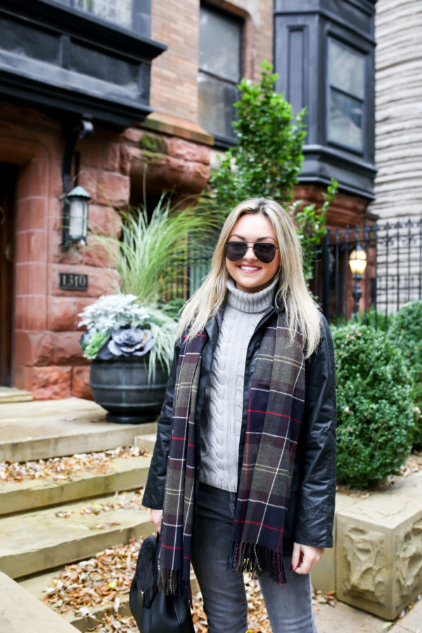 Fashion and lifestyle blogger Jessica Sturdy wearing Le Specs aviators, Barbour Beadnell Jacket, a grey turtleneck, and tartan scarf.