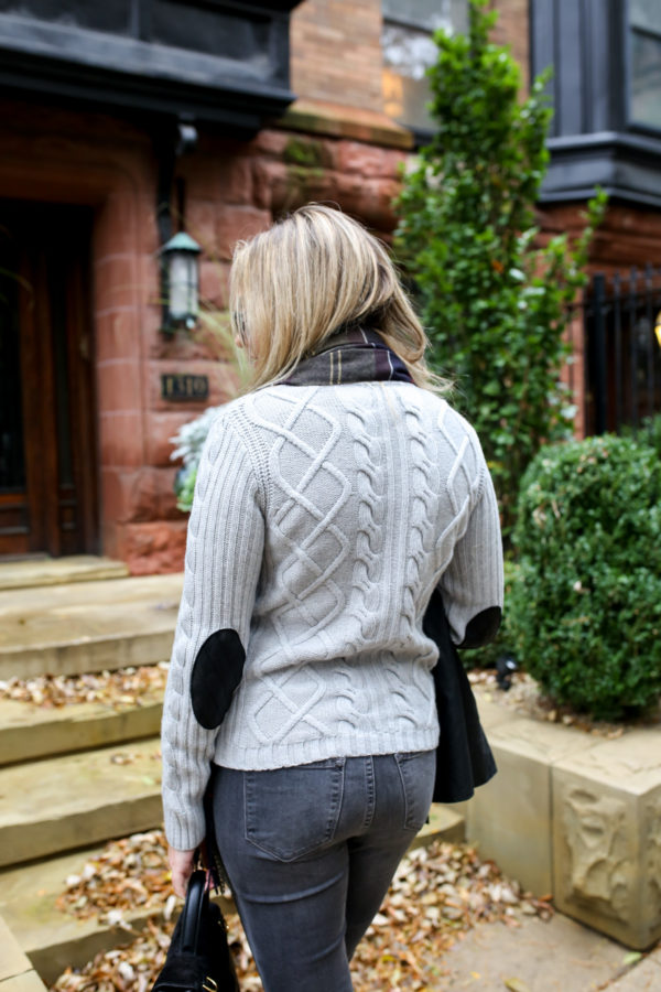 Chicago fashion and lifestyle blogger Jessica Sturdy wearing a Barbour cable knit grey sweater with elbow patches.
