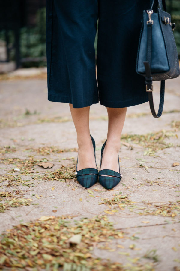 Jessica Sturdy wearing Old Navy blue culotte pants and J.Crew blackwatch plaid pumps.