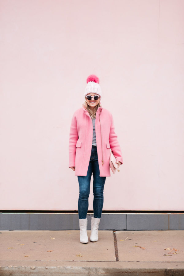 Jessica Sturdy wearing a Kyi Kyi pink pom pom hat, a J.Crew winter coat, Rag & Bone jeans, and Linea Paolo suede ankle booties via Nordstrom.