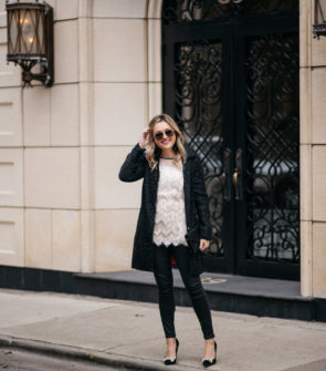 Jessica Sturdy wearing a Sail to Sable sparkly tweed coat, fringe tunic tank, Express waxed black denim, Kate Spade suede bow pumps, and Gucci aviators with an Old Navy embellished clutch.