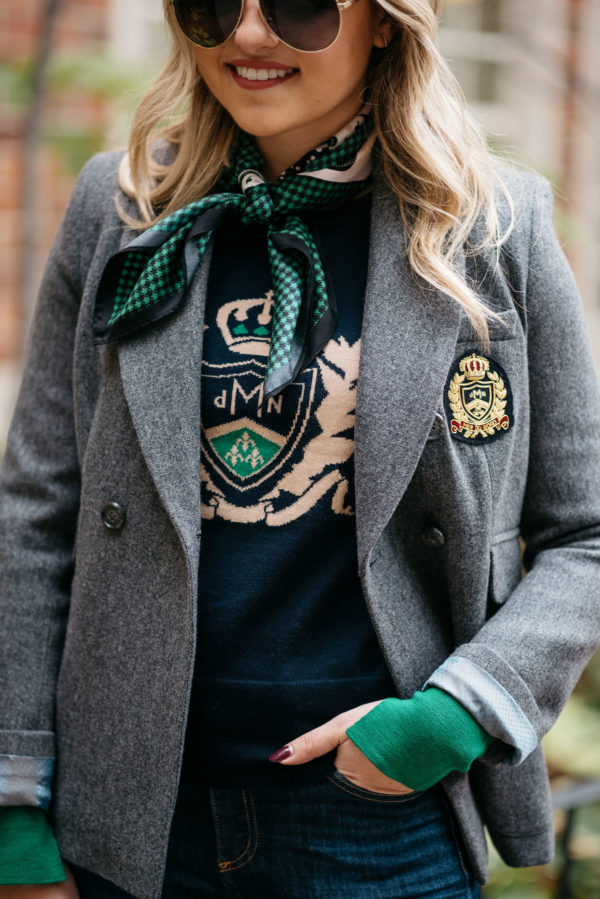 Chicago fashion blogger Jessica Rose Sturdy of Bows & Sequins wearing a green MDN silk neck scarf, a navy MDN crest sweatshirt, and a grey MDN crest blazer.