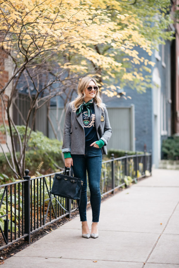 Fashion and lifestyle blogger Jessica Rose Sturdy wearing Gucci aviators, a MDN silk neck scarf, MDN grey blazer, Rag & Bone raw hem skinny jeans, and Michael Kors textured pumps with a navy Kate Spade tote.