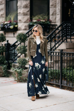 Chicago fashion blogger Jessica Sturdy wearing a floral maxi dress in the fall with a suede moto jacket, cream turtleneck, and suede over the knee booties.