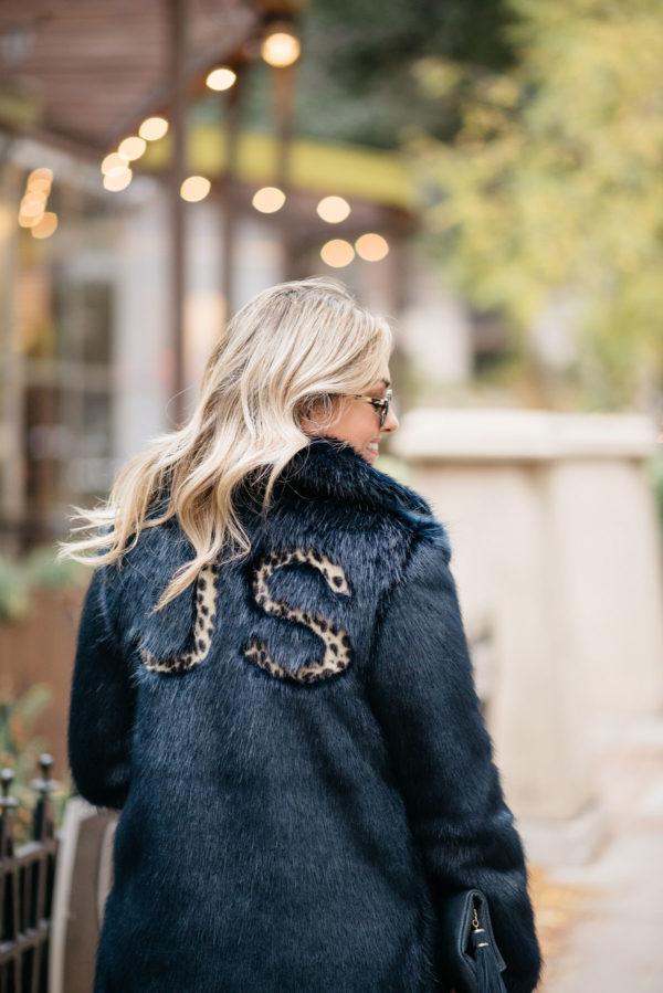 Jessica Sturdy wearing a custom leopard print monogram faux fur coat.