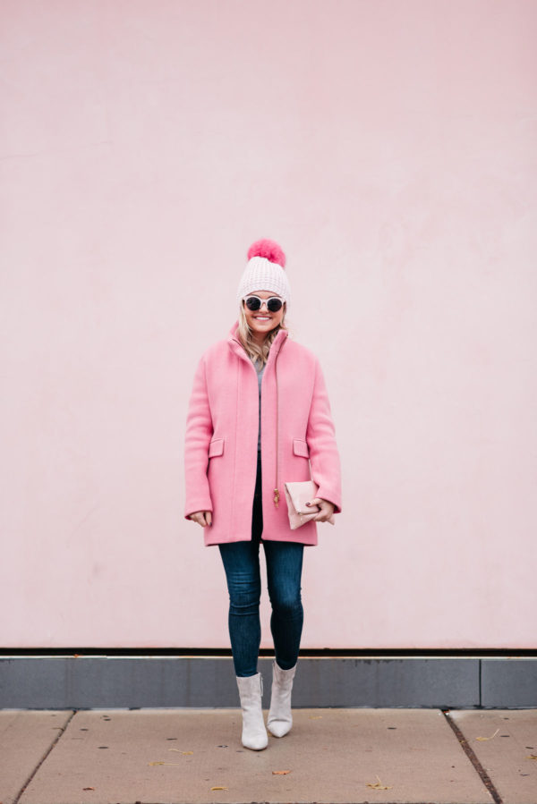 Jessica Rose Sturdy wearing a Kyi Kyi pink pom pom hat, a J.Crew winter coat, Rag & Bone jeans, and Linea Paolo suede ankle booties via Nordstrom.