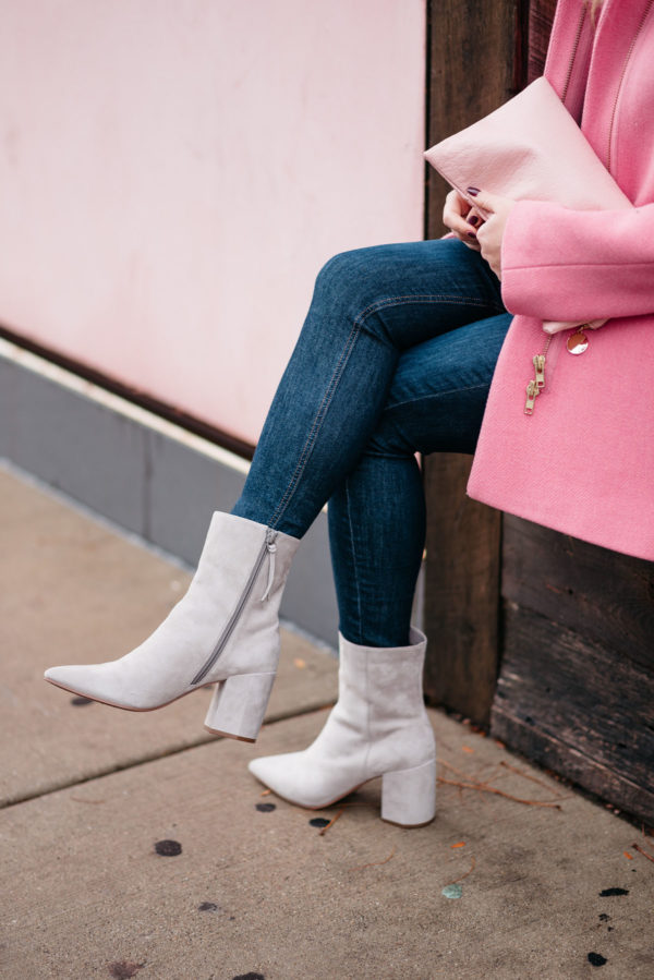 Chicago blogger Jessica Rose Sturdy wearing a J.Crew pink cocoon coat, Rag & Bone skinny jeans, and Linea Paolo suede ankle booties.
