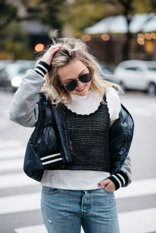 Chicago lifestyle blogger Jessica Rose Sturdy wearing Le Specs matte black aviators, a Veronica Beard puffer bomber jacket, and an Endless Rose layered tee and crochet tank.