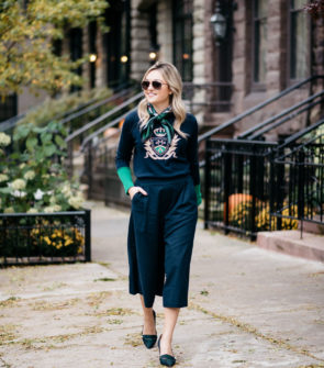 Jessica Sturdy wearing Gucci aviators, a silk neck scarf, MDN crest sweater, Old Navy blue culotte pants, and J.Crew blackwatch plaid pumps with a Kate Spade navy tote.