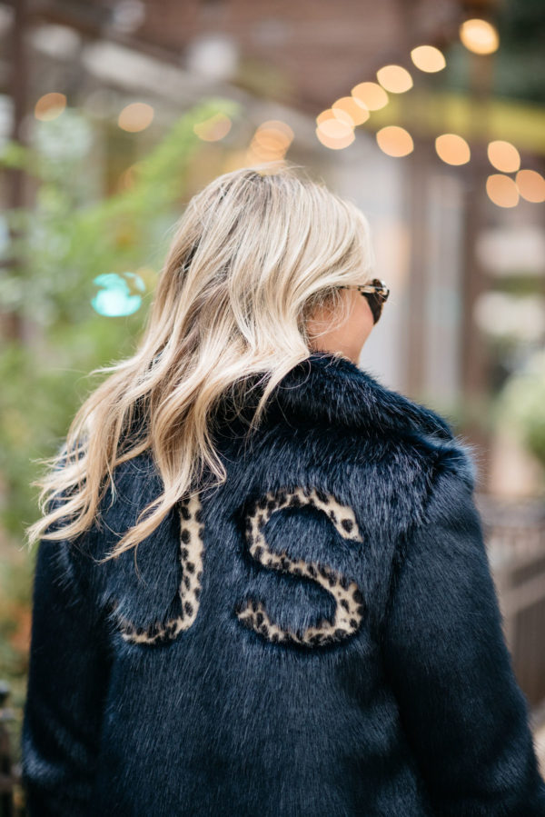 Jessica Sturdy wearing a custom leopard print monogram faux fur Miranda Dunn London coat with Illesteva sunglasses.