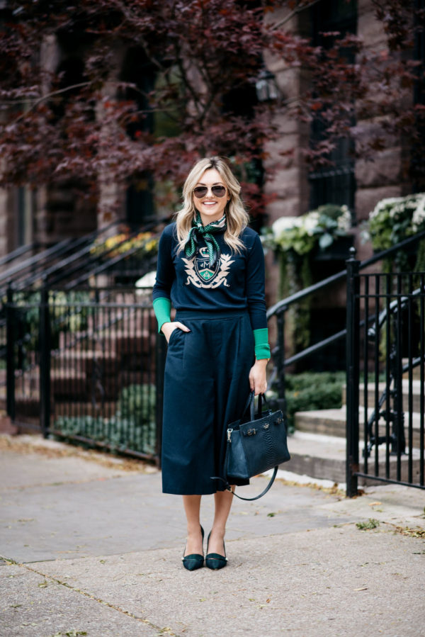 Chicago fashion blogger Jessica Rose Sturdy wearing Gucci aviators, a silk neck scarf, MDN crest sweater, Old Navy blue culotte pants, and J.Crew blackwatch plaid pumps with a Kate Spade navy tote.