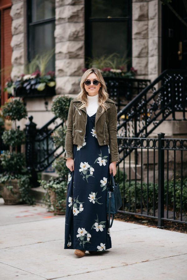 Chicago fashion blogger Jessica Sturdy of Bows & Sequins wearing a floral maxi dress in the fall with a suede moto jacket, cream turtleneck, and suede over the knee booties.