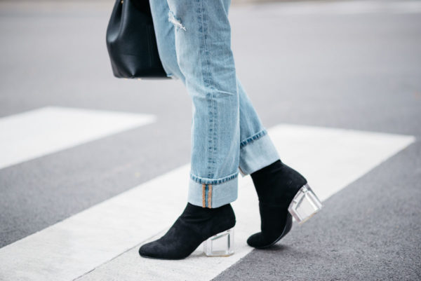Jessica Sturdy of Bows & Sequins wearing Levi 501 jeans with Steve Madden lucite booties.