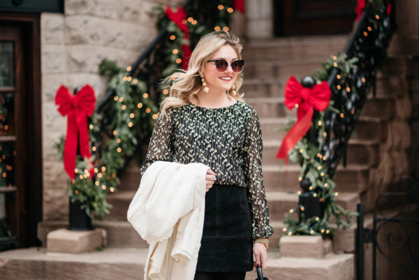 Bows & Sequins styling a black and gold blouse for work during the holiday season.