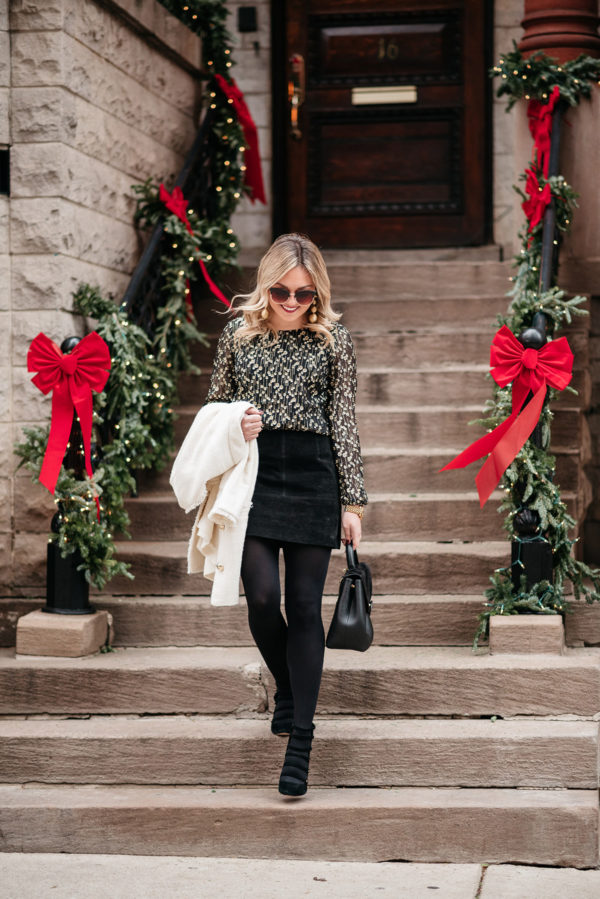 Jessica Sturdy wearing a black suede skirt during the holiday season.