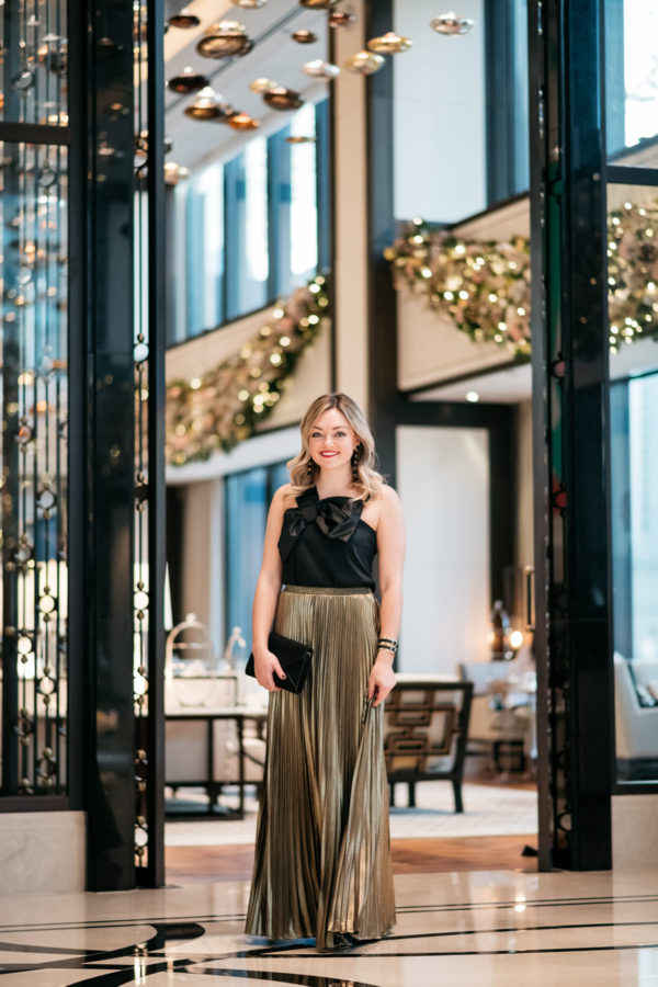 Chicago blogger Jessica Rose Sturdy wearing a J.Crew black bow top,