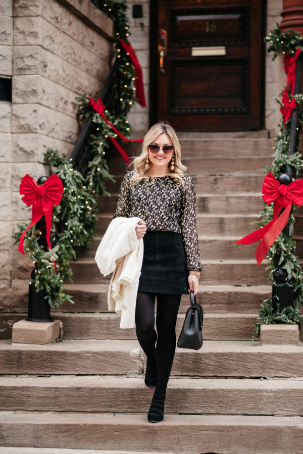 Jessica Sturdy wearing a black and gold work outfit for the holidays.