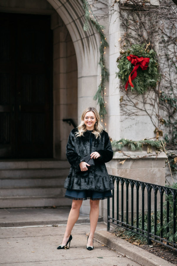 Jessica Sturdy wearing a faux fur coat and Kate Spade bow pumps.