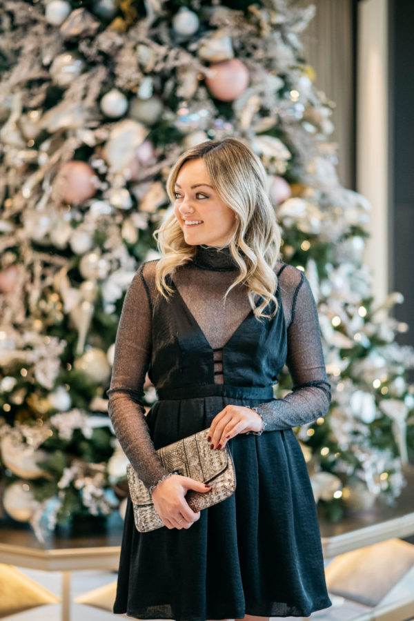 Jessica Sturdy wearing a Free People dress with a sparkle bodysuit, Loren Hope earrings, and a Milly metallic clutch.