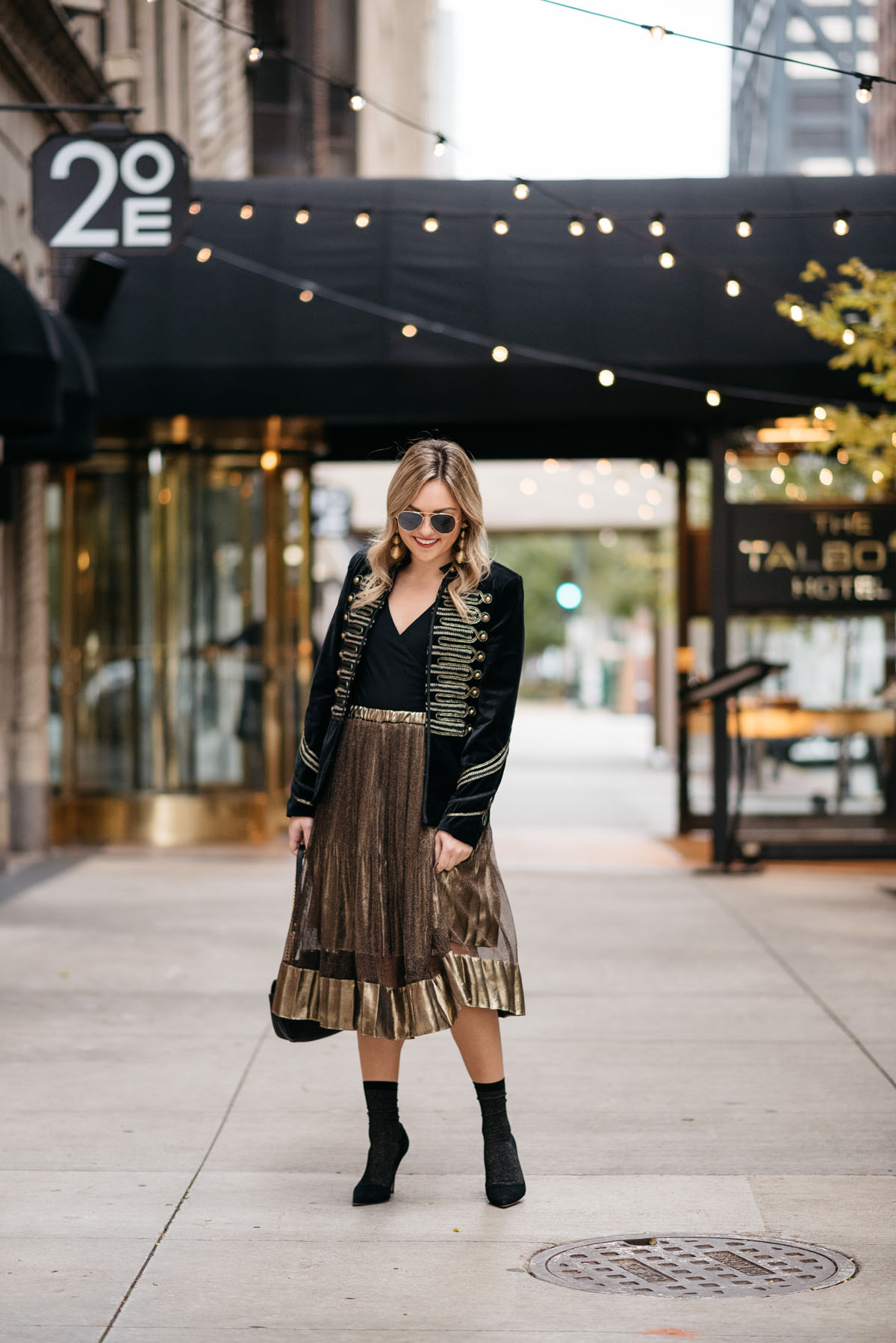 Chicago blogger Jessica Rose Sturdy wearing Ray-Ban aviators, Blank NYC black velvet and gold embroidered band jacket, J.Crew bodysuit, gold midi skirt, black & gold shimmer socks, and Kate Spade black suede pumps with Kenneth Jay Lane gold earrings and a Gucci Marmont black leather bag.