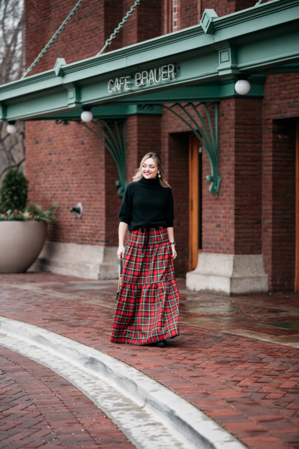 Jessica Sturdy wearing a black turtleneck and plaid tartan maxi skirt for Christmas.