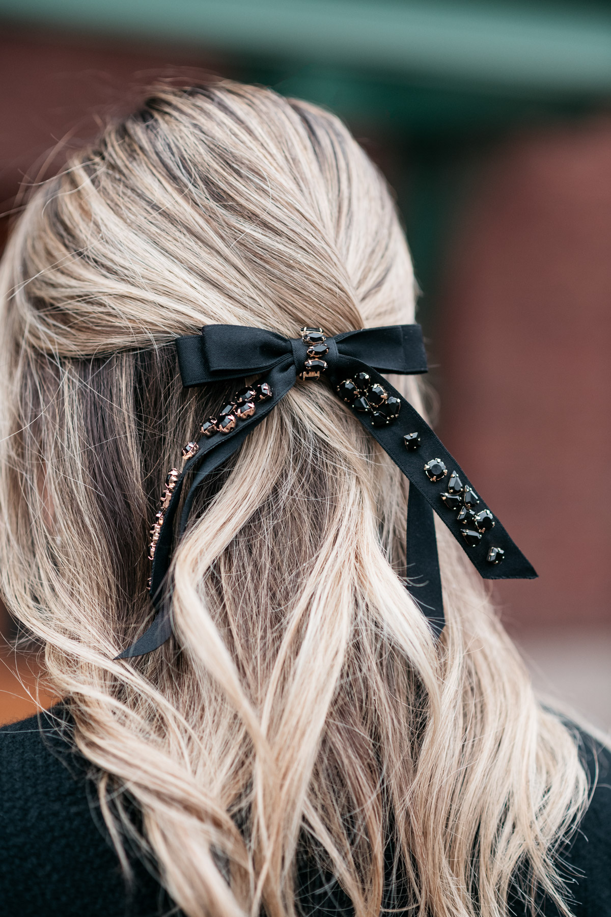 Jessica Sturdy wearing a black jeweled hair bow from J.Crew.