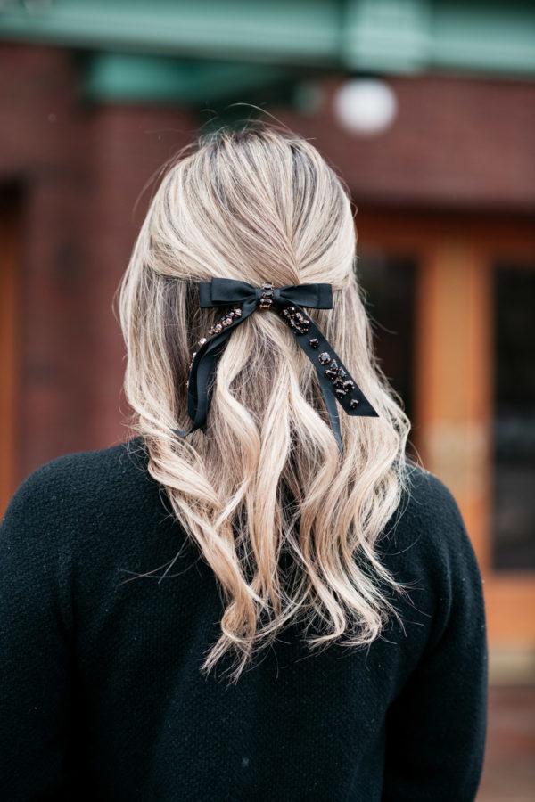 Jessica Sturdy wearing a black jeweled hair bow barrette from J.Crew.