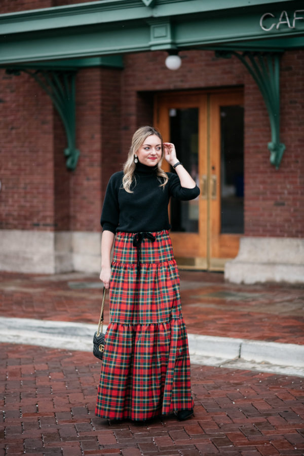 Jessica Sturdy sharing how she styled her J.Crew plaid maxi skirt with a black turtleneck and sparkly Loren Hope earrings.