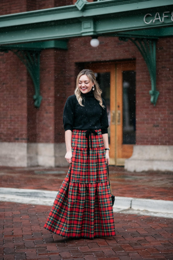 Jessica Sturdy wearing a black turtleneck and plaid maxi skirt.