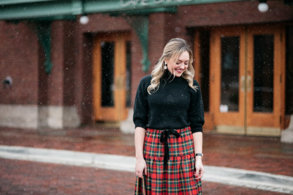 Jessica Sturdy wearing a plaid skirt in the snow in Chicago.