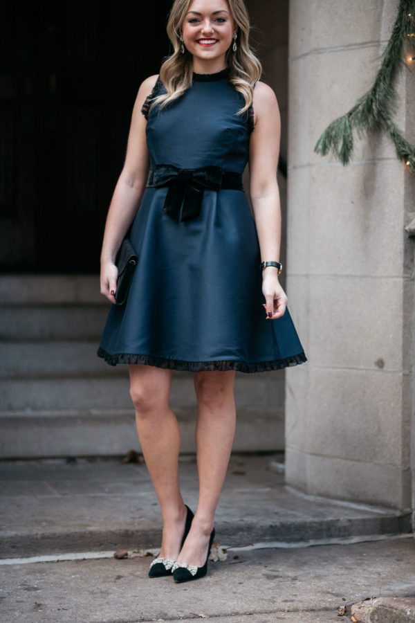 Jessica Sturdy wearing a navy Kate Spade dress with a black bow from Nordstrom and bow pumps.