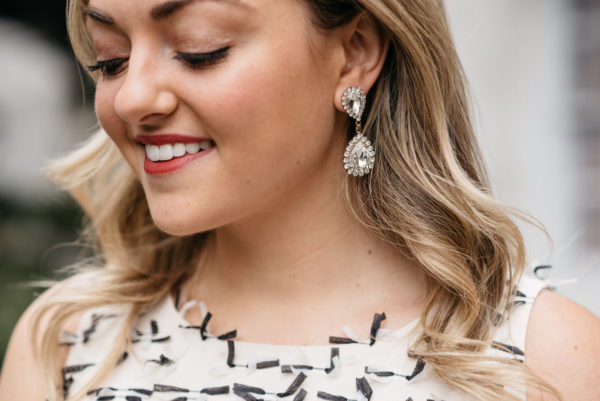 Jessica Sturdy wearing Loren Hope drop earrings and a Sail to Sable bow dress.
