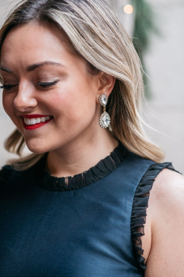 Jessica Sturdy of Bows & Sequins wearing Loren Hope earrings and a navy and black Kate Spade dress from Nordstrom.