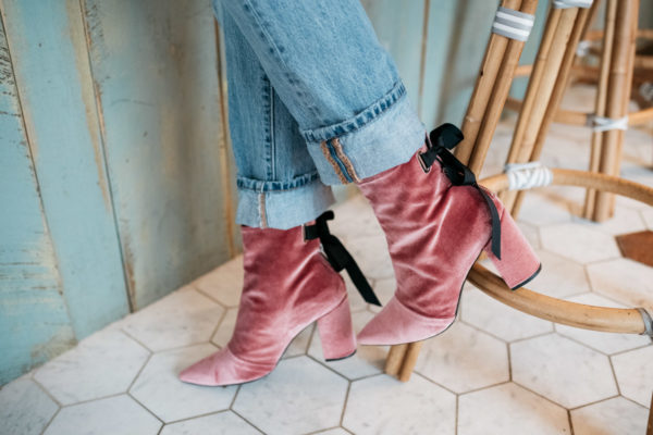 Fashion blogger Jessica Sturdy wearing pink velvet booties and cuffed Levi's 501.