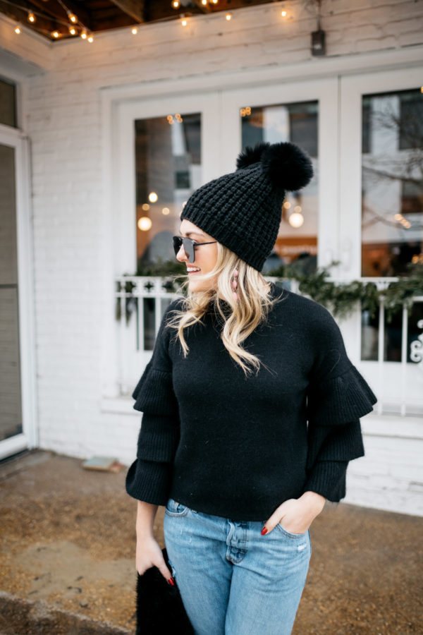 Jessica Sturdy wearing an Endless Rose ruffle sleeve sweater, aviators, and a pom pom beanie.