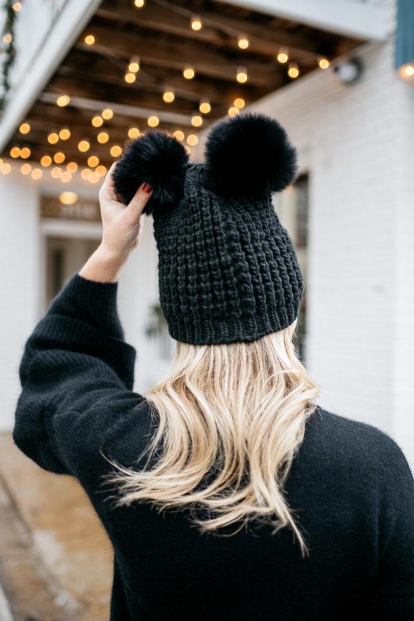 Jessica Sturdy wearing a fur pom pom beanie.