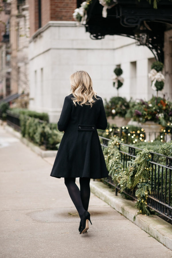 Lifestyle and fashion blogger Jessica Sturdy wearing Loren Hope earrings, a Ralph Lauren black wool coat, J.Crew tights, and Kate Spade black pumps.