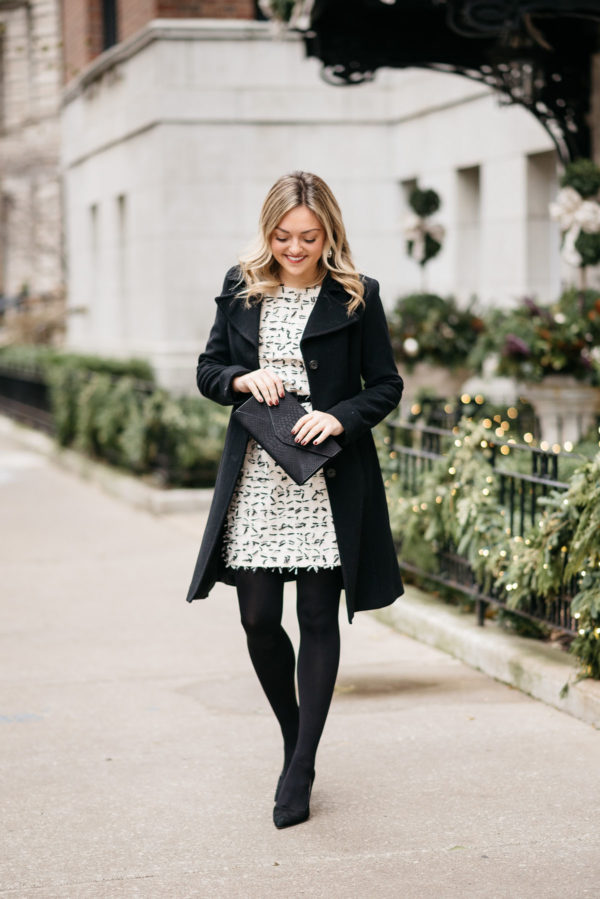 Jessica Rose Sturdy wearing a Ralph Lauren black wool coat, Sail to Sable bow dress, J.Crew black tights and Kate Spade pumps with a J.Crew bow belt and a black envelope clutch.