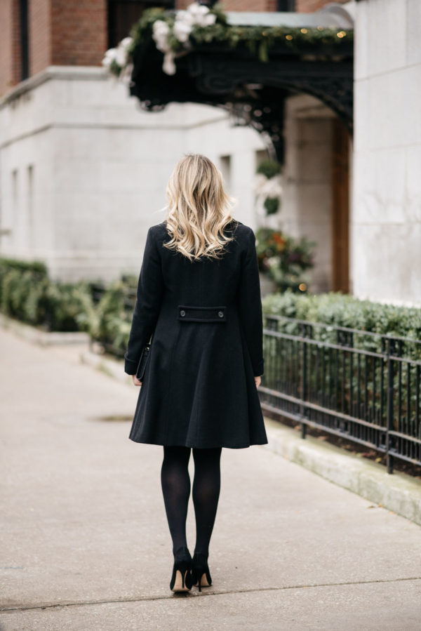 Chicago fashion blogger Jessica Sturdy wearing Loren Hope earrings, a Ralph Lauren black wool coat, J.Crew tights, and Kate Spade black pumps.